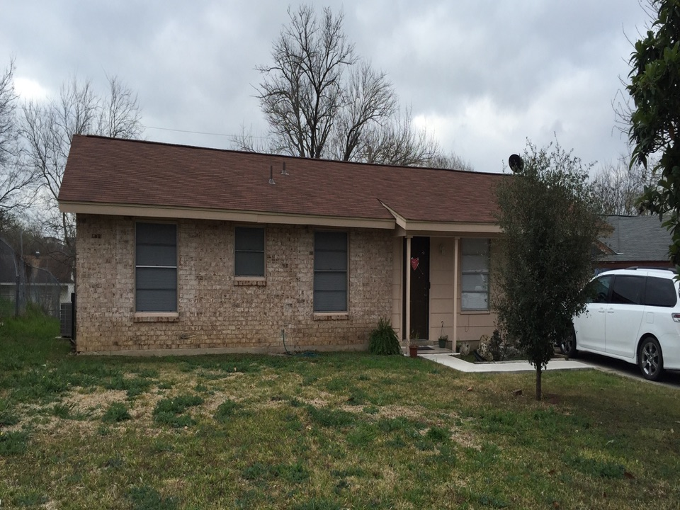 San Antonio, TX - We installed GAF Royal Sovereign shingles in Autumn Brown on this rental property near Lackland AFB. It really goes nicely with the brick.