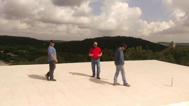 Austin, TX - Putting finishing touches on a flat roof on a house using Expandothane.