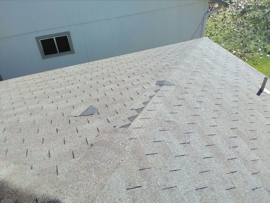 Austin, TX - Missing shingles and rotted decking