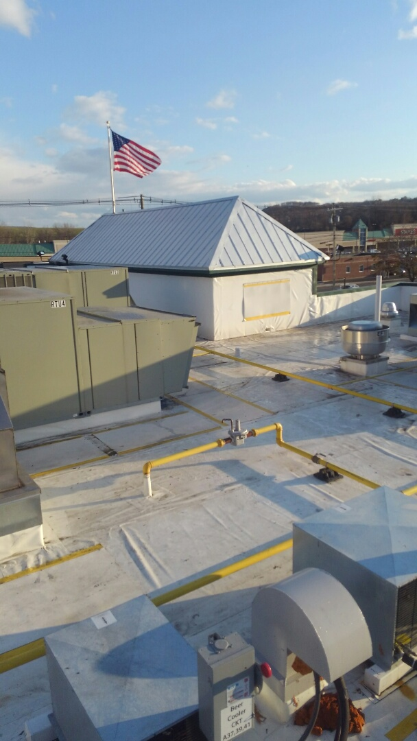 Danbury, CT - 2 flag poles leaking wrapped the pipes inside the roof and installed plywood and flashed wall where removed