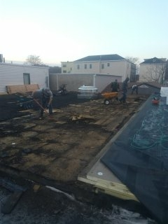 T-shirts at seven am in November. Ripping tar and gravel down to the deck. New two layers of insulation and a mechanically fastened 60 mil Firestone epdm. Getting it done!