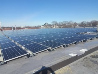 Installing a spill out on this dark grey Carlisle TPO roof we installed back in the fall. Now cover entirely in solar!!!