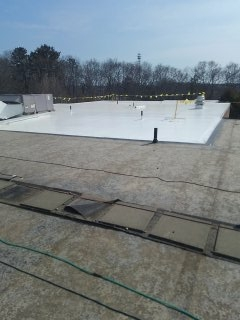 Getting started on this 500+ sq. roof. 1/2 inch HD overlay with Durolast membrane.