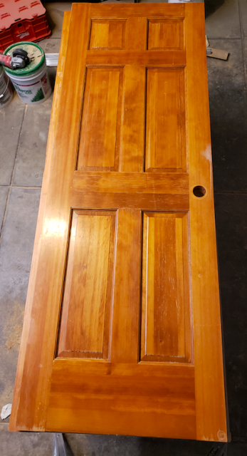 Castle Rock, CO - Solid Wood Interior Doors scratched by dogs from previous Homeowners.  Doors stripped and sanded to accept new finish of Colonial Maple Stain & clear coat coverage.
