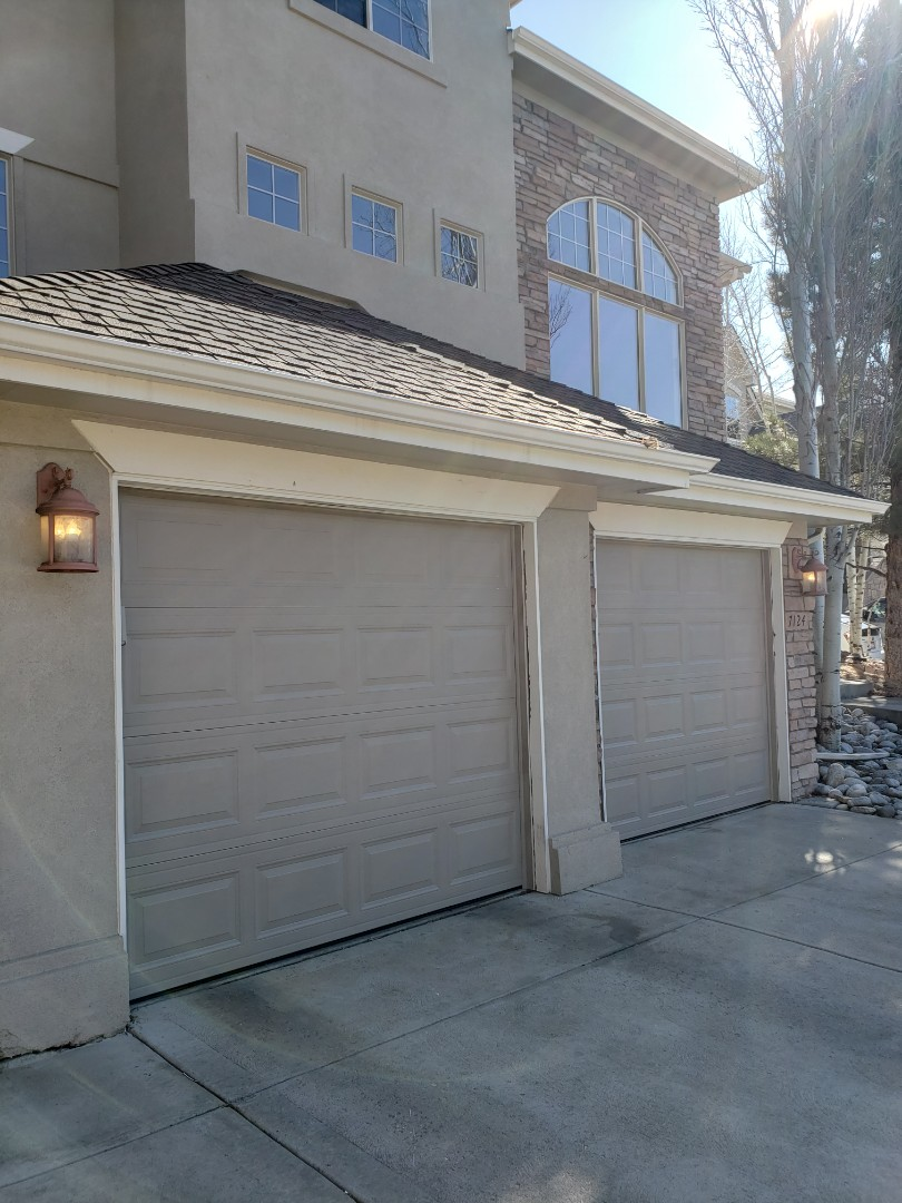 Castle Rock, CO - Two 8' x 7' Replacement Garage Doors with Sandstone paint coverage.  Amarr Garage Door's Lincoln 1000 Short Panel ordered white and painted by Brewer Garage and Door.
