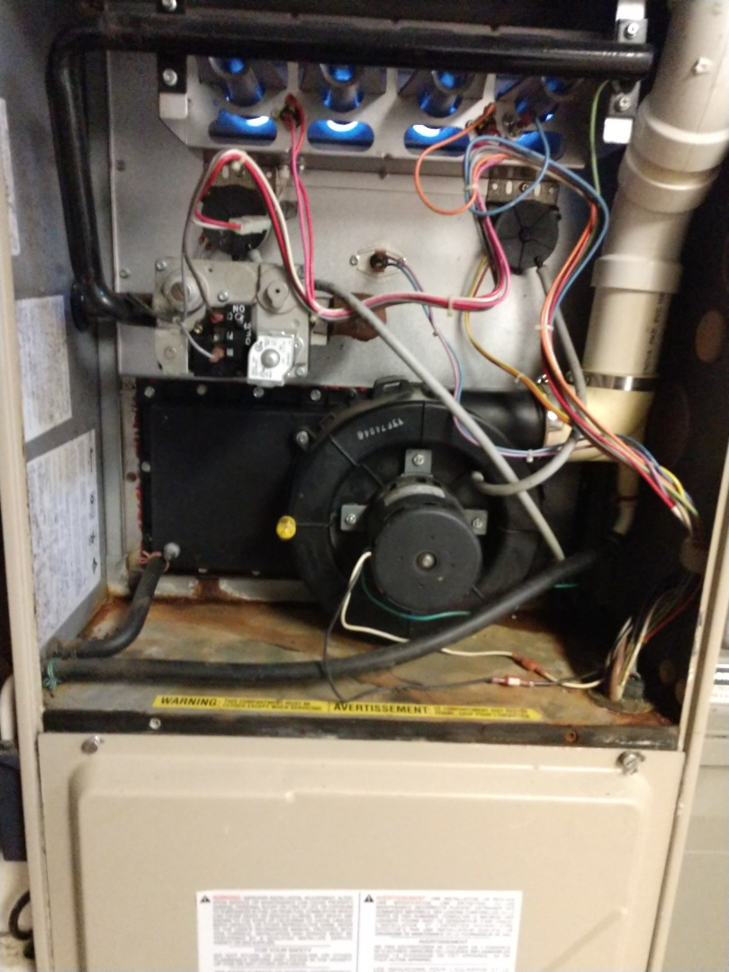 Grand Rapids, MI - Replaced leaking recoup cover on Amana high efficiency furnace.