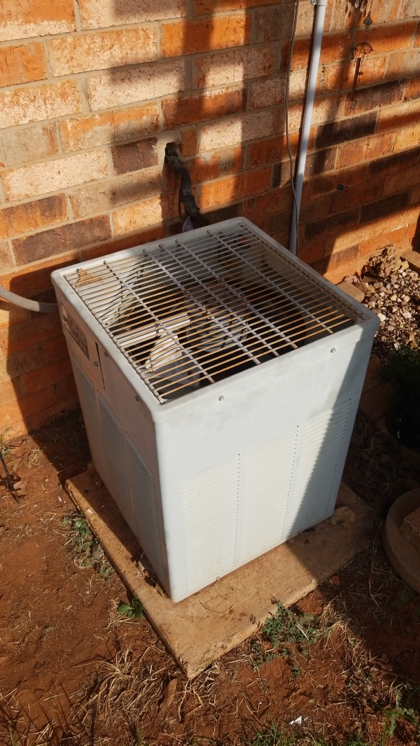 Blanchard, OK - Repairing an air conditioner for. Family in Blanchard Oklahoma