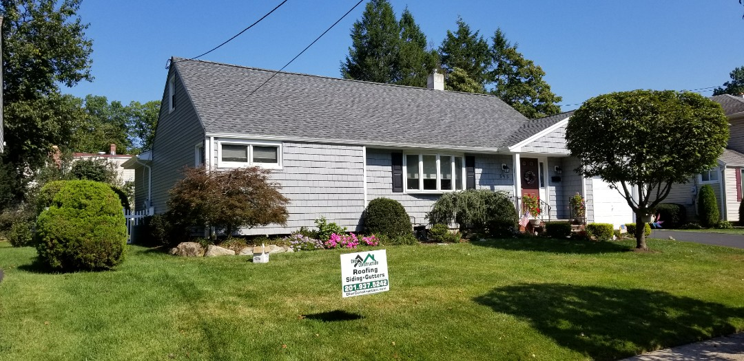 New Milford, NJ - Beautiful transformation  completed on this lovely home in New Milford using GAF Timberline Pewter Gray shingles and Norandex Woodsman Select Granite color siding.  Another happy customer!