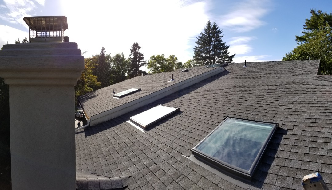 Closter, NJ - Just completed a large roof in Closter, NJ using GAF Timberline HD Pewter Gray Shingles and 6 new Velux skylights.  A beautiful transformation