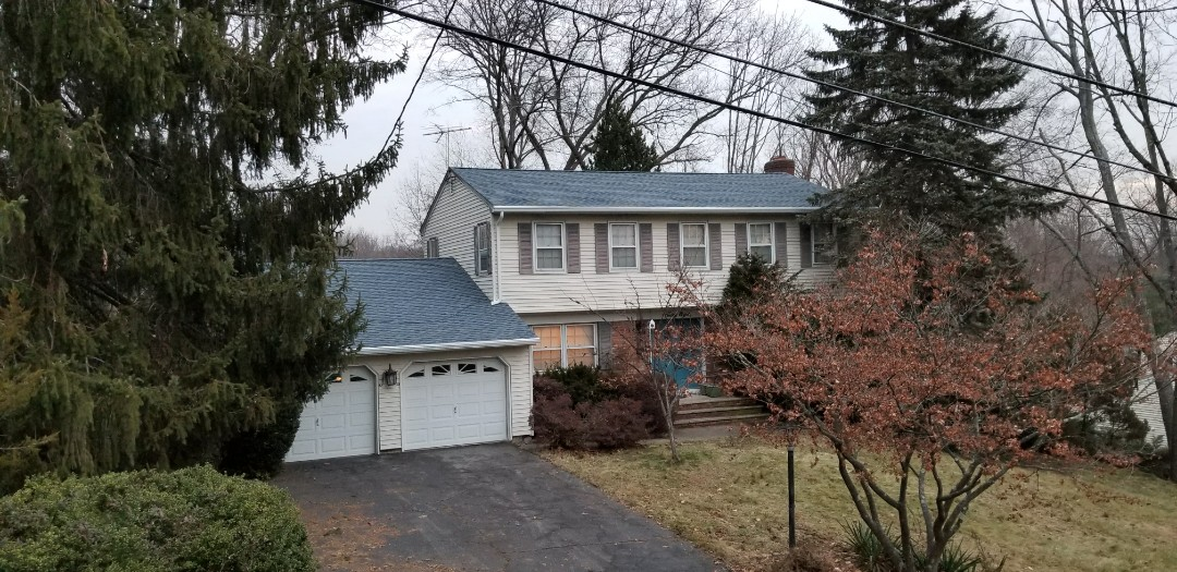 Park Ridge, NJ - Another one day Roof completed using GAF's Timberline HD Biscayne Blue Shingles.  Keep it up team!