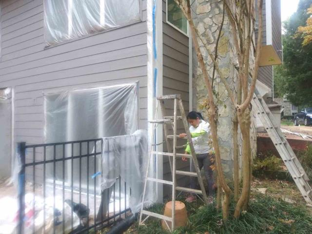 Atlanta, GA - Our paint crews work hard and their work shows it.  This home had new James Hardie Siding installed and now we are painting it.  The gray color with white trim is a popular color combination.
