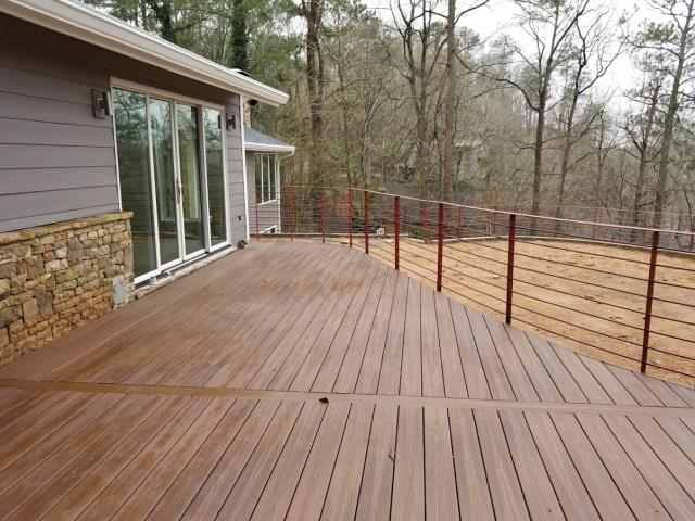 Atlanta, GA - Reviewing this newly built deck and railing at an Atlanta renovation.  The railing will be painted black this week.  This is the last part of a very large remodel which included Siding and Trim Replacement, Stone, Back Yard Leveling (removing a pool), Painting, and Gutters.