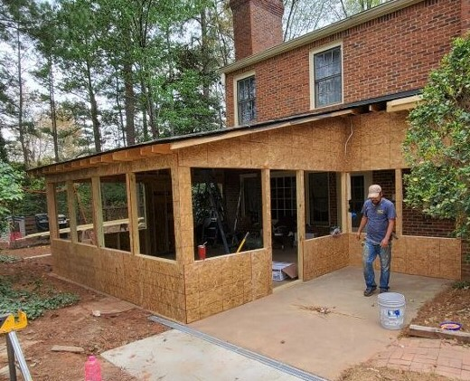 Roswell, GA - The Roof, Framing, and Walls are up of this new Screened In Porch.  Siding, Painting, Gutters, Screens, and the Door are next and these homeowners will be relaxing and enjoying the outdoors in no time.