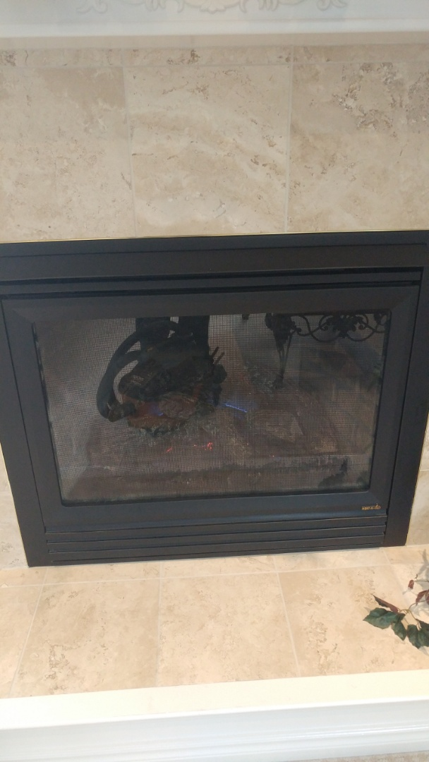 Niagara-on-the-Lake, ON - Cleaning and inspection of Heat n' Glo fireplace.