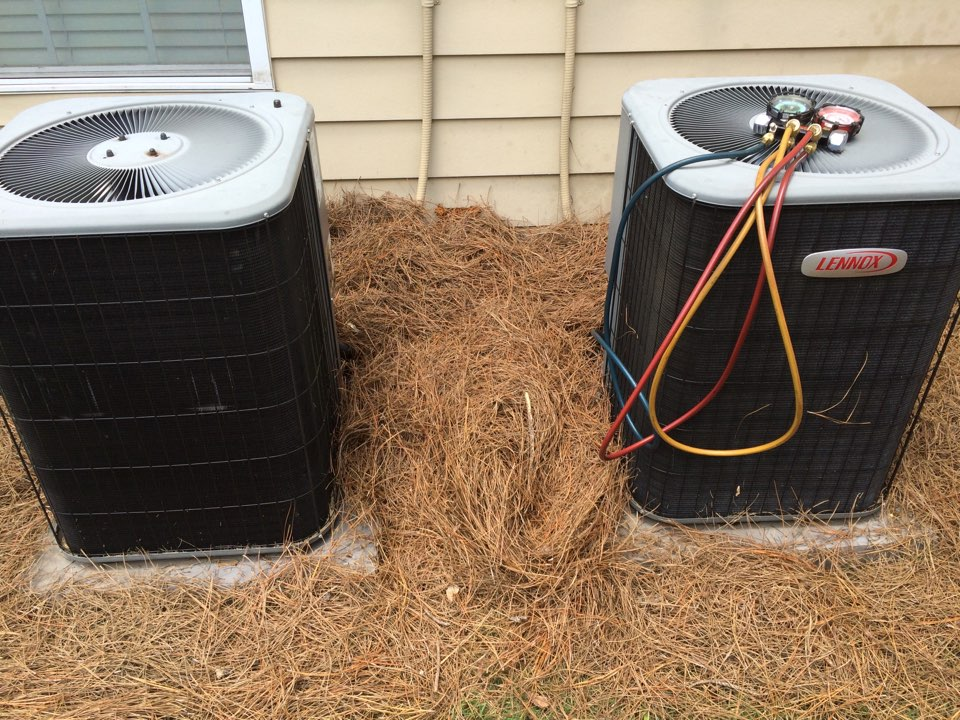 Working on 2 Lennox air conditioners.