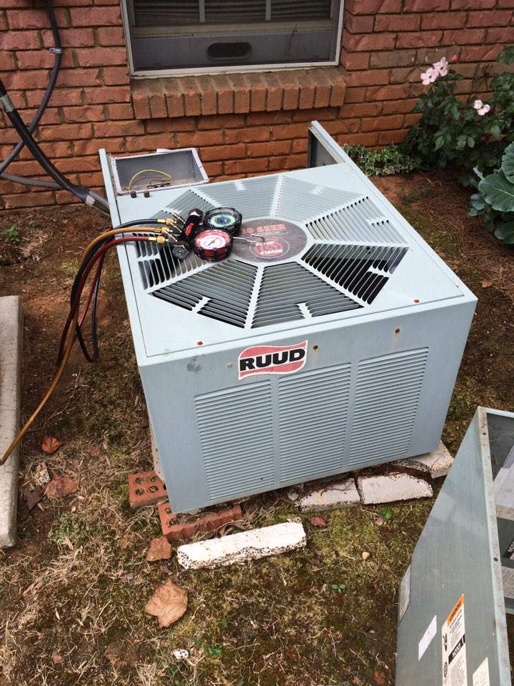 Working on a rheem a/c.