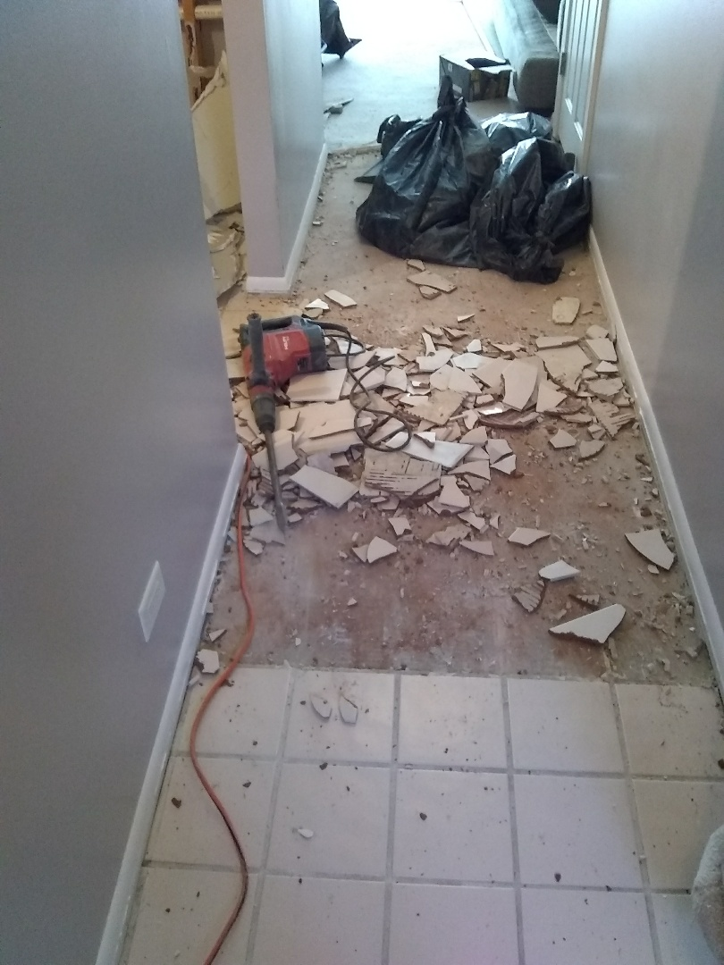 Schaumburg, IL - Removal of ceramic tile from hallway, new laminate flooring will be installed.