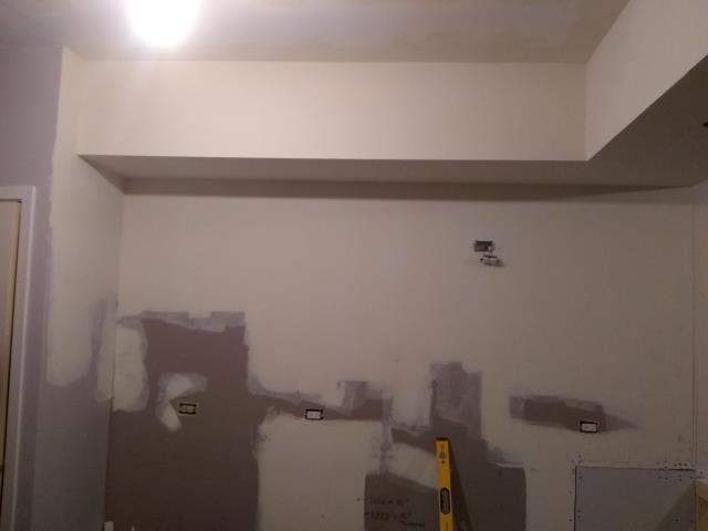 Schaumburg, IL - Soffit is raised, new kitchen cabinets will be installed on this wall.