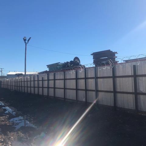 Dallas, TX - Install 3 strands barbed wire and and razor wire
