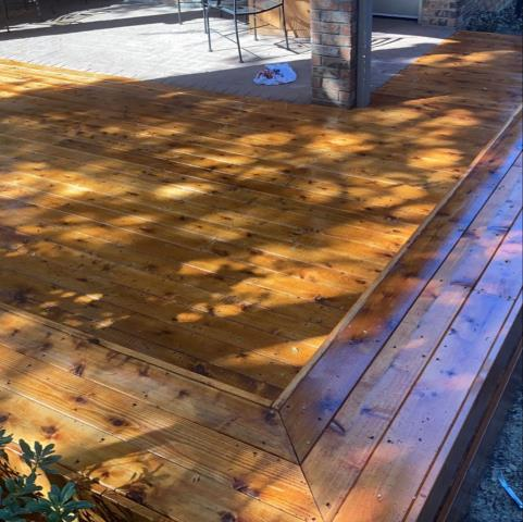 Dallas, TX - Redeck existing deck with cedar, rebuild bench seats and stain using ready seal pecan stain