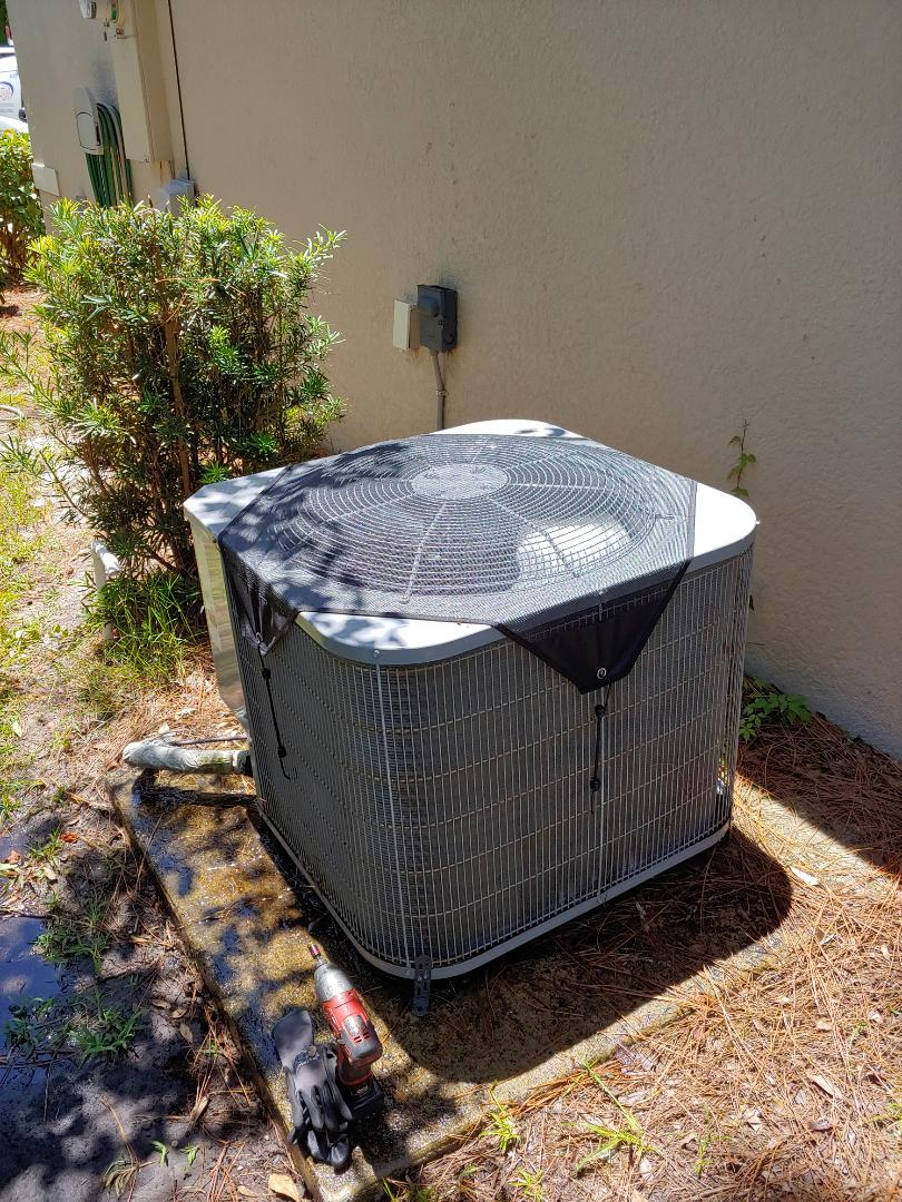 Palm Coast, FL - Installed leaf guard on carrier heat pump.