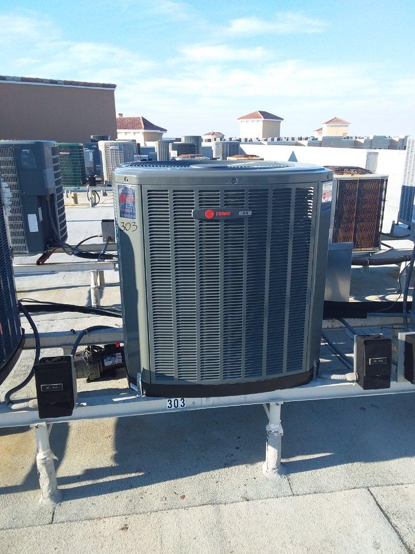 Palm Coast, FL - Heat pump install . Surf Club Condo. 3 ton XR15 Trane