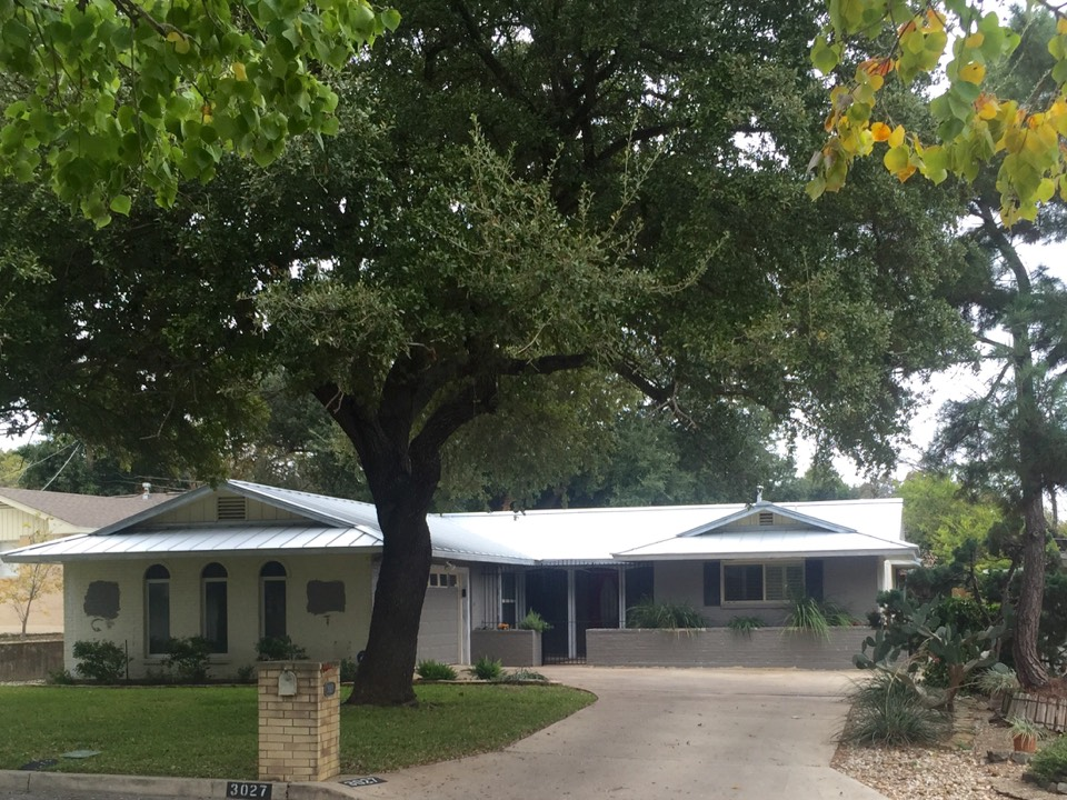 San Antonio, TX - Metal roofing roof replacement and skylight instillation on this lovely Alamo Heights home. Go mules!