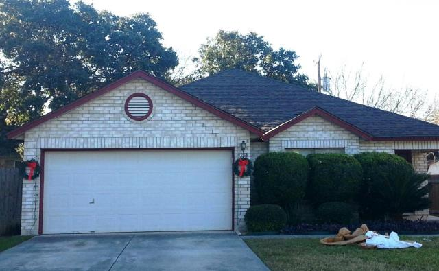 San Antonio, TX - Roof replacement with Teak O.C. Oakridge True Definition shingles.