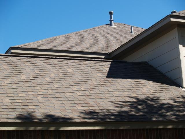 San Antonio, TX - Repair and Replacement of Gutters and Weatherwood Dimensional Shingles on this stunning San Antonio home.
