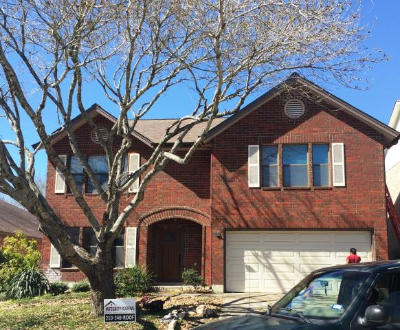 San Antonio, TX - Roof replacement on this beautiful 2 story home using Teak Duration shingles.