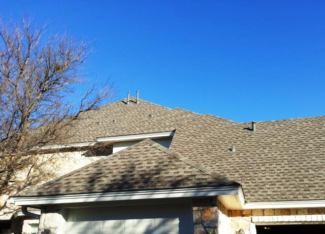 Helotes, TX - Roof replacement using GAF shingles on beautiful 2-story home in Helotes, TX.