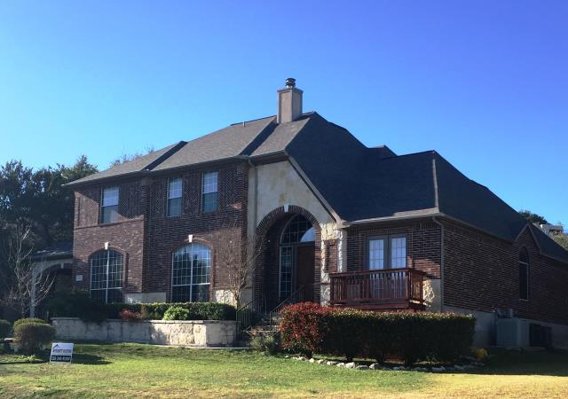 San Antonio, TX - Roof replacement on gorgeous two story home using Owens Corning Oakridge shingles.