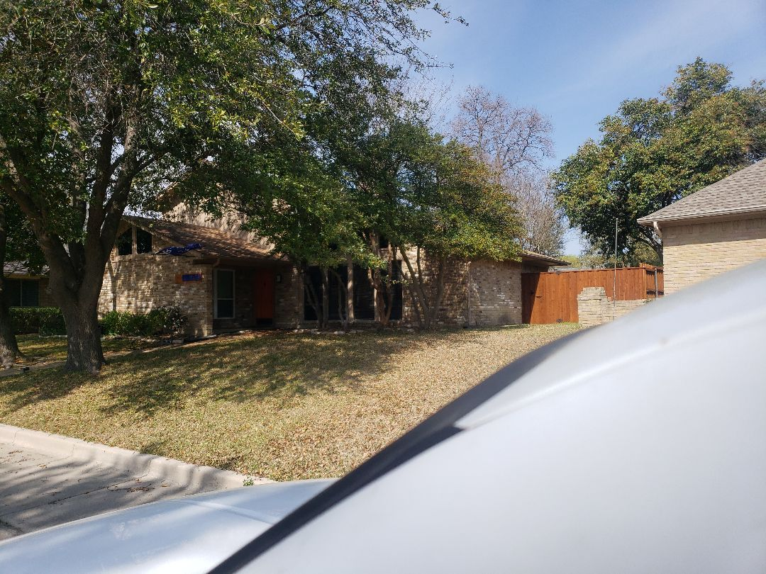 Richardson, TX - Measuring a shingled roof for replacement with standing seam metal roofing and copper or paint grip metal half round gutters.
