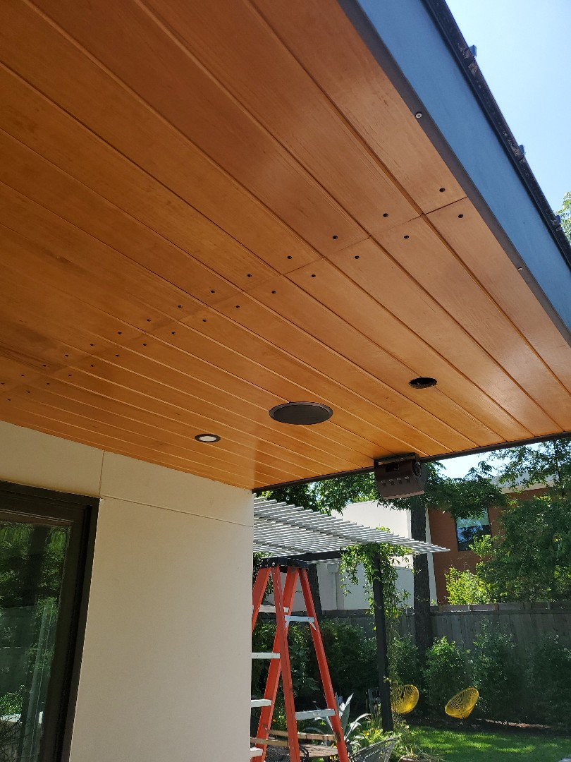 Dallas, TX - Installing light under our custom patio