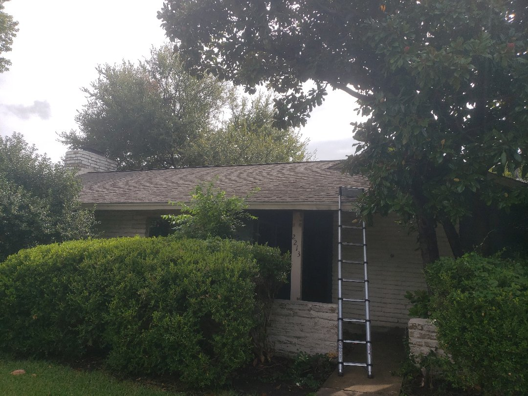 Richardson, TX - Homeowner wants a bid to replace her 15 year old laminate shingle roof with a new impact resistant shingle from GAF or Certainateed.
