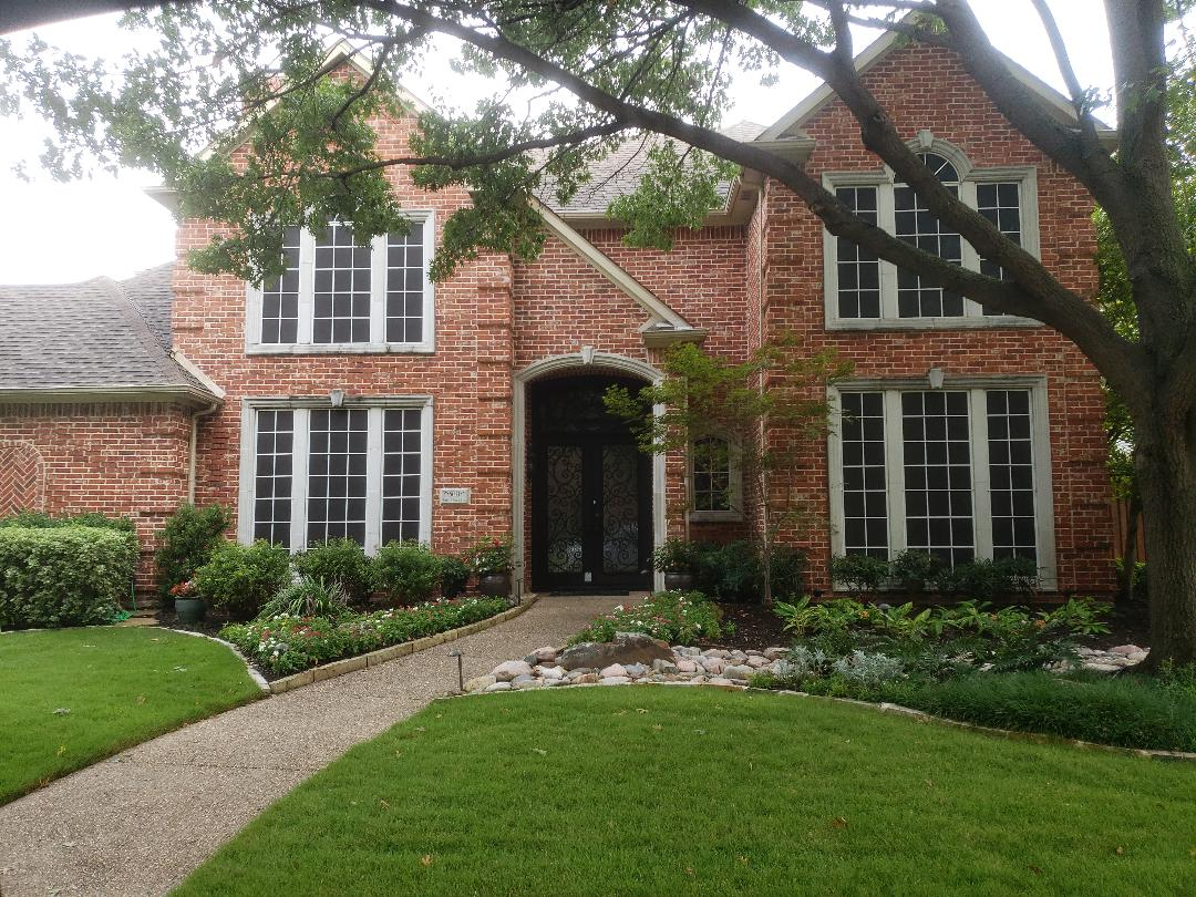 Plano, TX - Meeting with homeowner to discuss roof replacement with GAF Grand Sequoia impact resistant shingles.