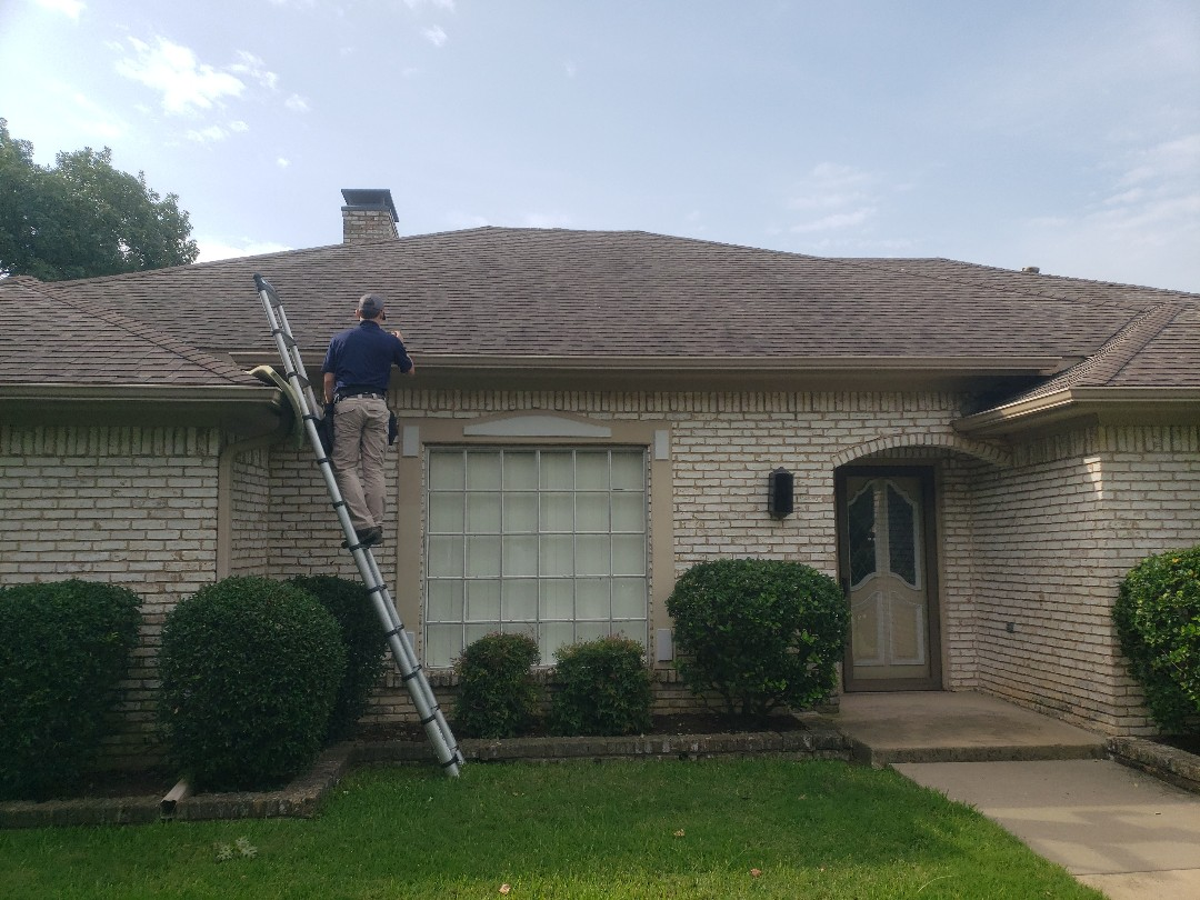 Dallas, TX - Meeting with a USAA insurance adjuster ro discuss storm damage to this 17 year old roof.