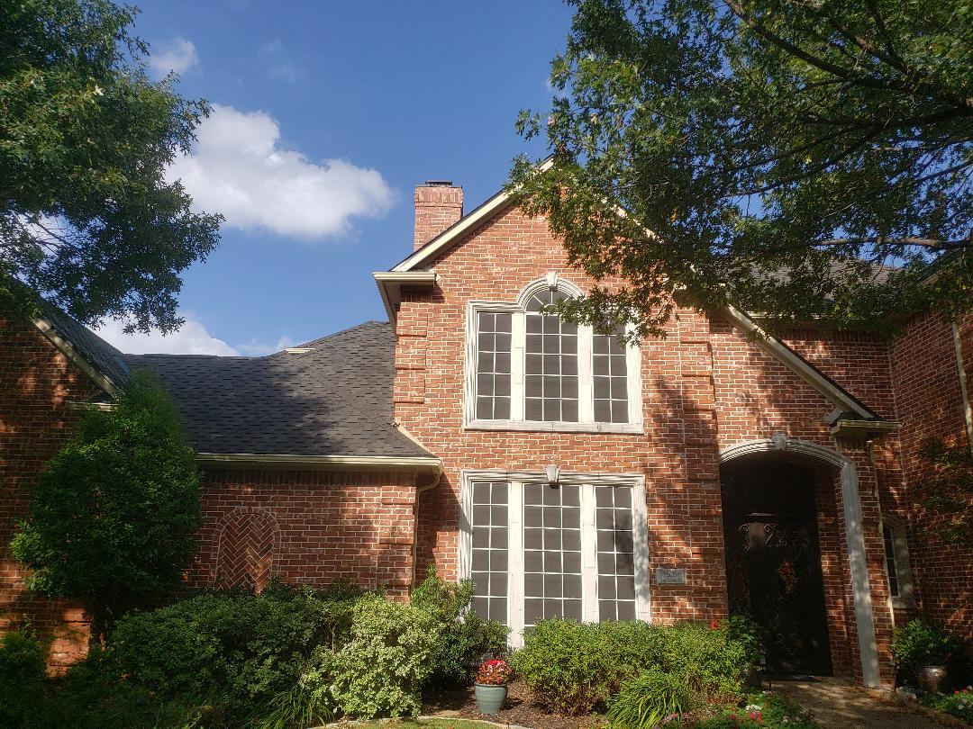 Plano, TX - Completing final items on this beautiful GAF Grand Sequoia Armorshield roof in Dusky Grey.