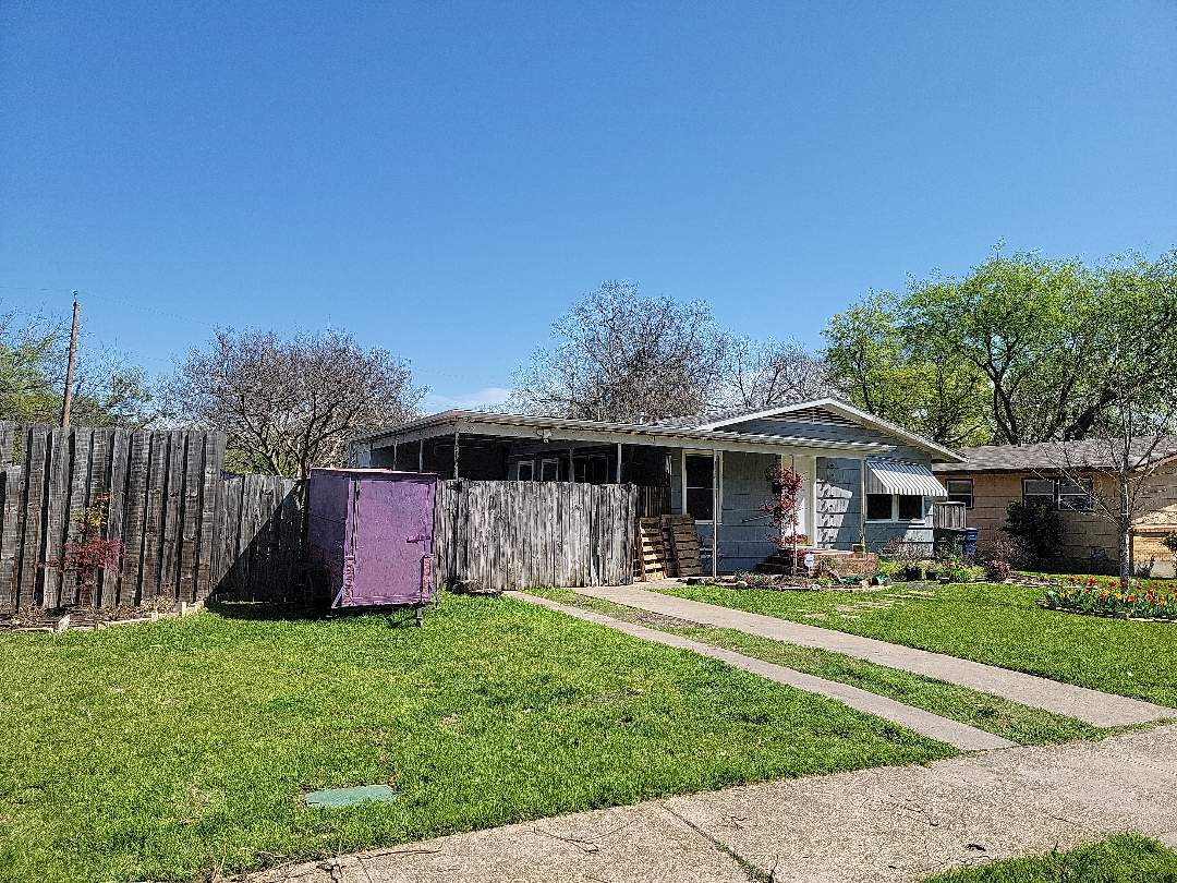 Garland, TX - Measuring a roof for replacement.