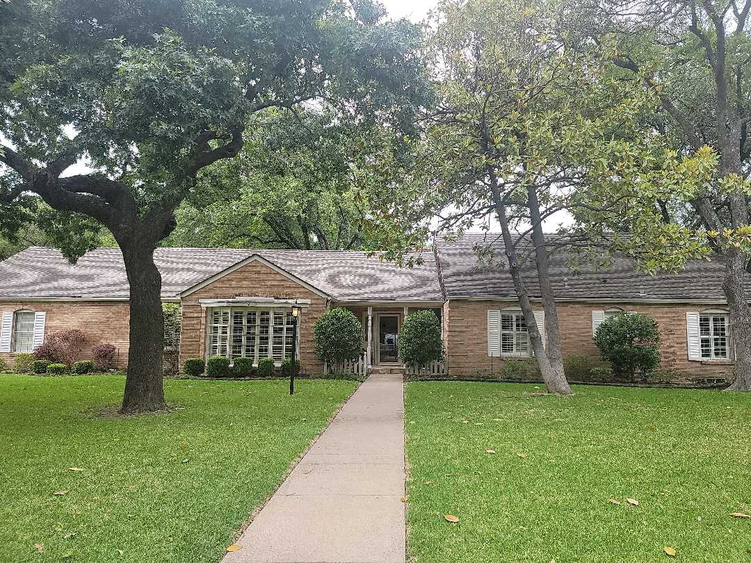 Dallas, TX - Locating a roof leak on this home. It could be on the GAF 50 year weathered wood portion, the standing seam metal roof, or the rubber (edpm or pvc) roof flat roof section.