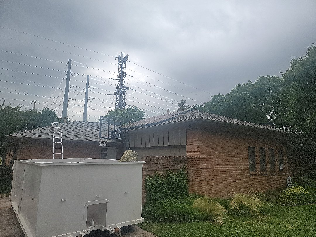 Dallas, TX - Looking at an active leak and inspecting this North Dallas roof for hail damage.