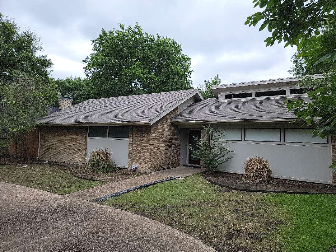 Dallas, TX - Inspecting a roof for a realtor that has a contract on this house. The inspection report deferred to a professional roofing contractor to evaluate the roof.