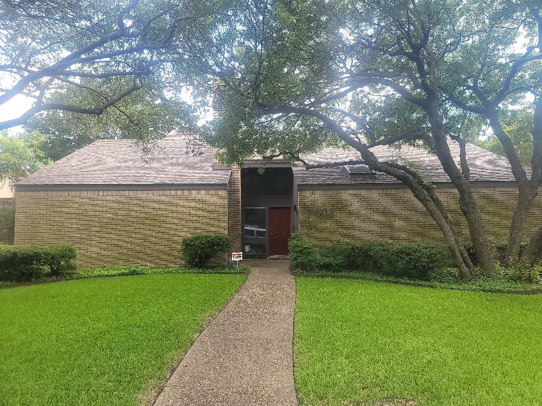 Dallas, TX - Looking at the chimney flashing as a possible cause of leakage.