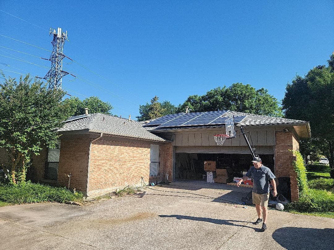 Dallas, TX - Meeting with an electrician to discuss detach and reset of these solar panels so we can install the roof next week.