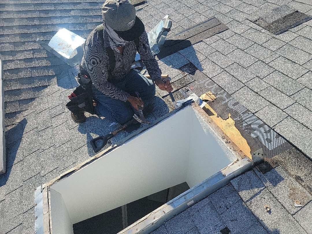 Dallas, TX - Replacing poorly installed skylight flashing.