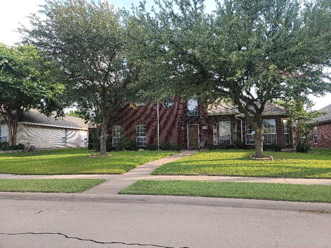 Garland, TX - Measuring a fence for replacement