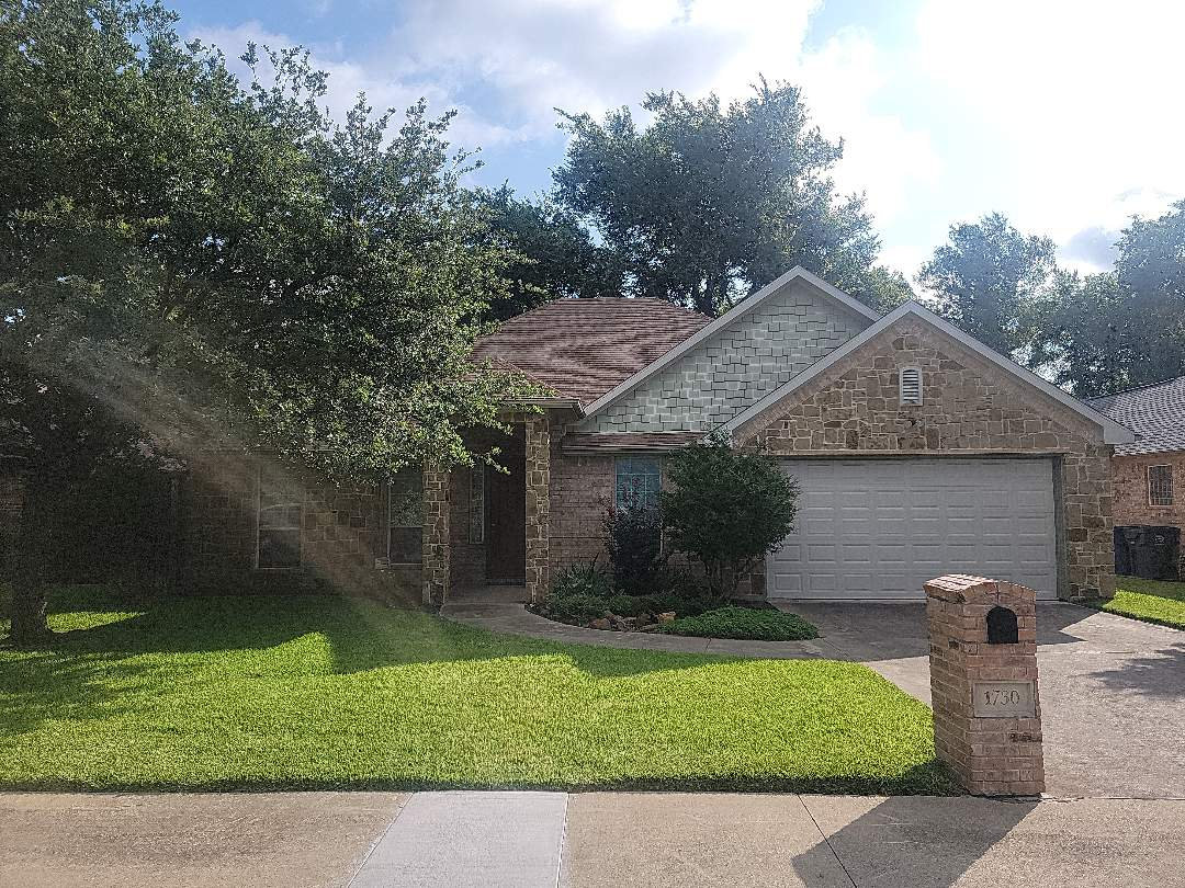 Dallas, TX - Measuring a roof for replacement with laminated architectural shingles.