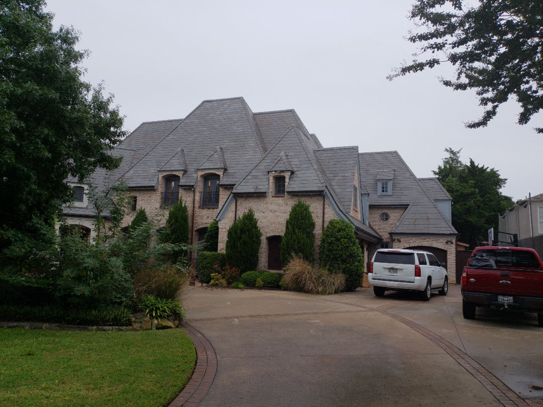 Dallas, TX - Inspecting this slate roof.