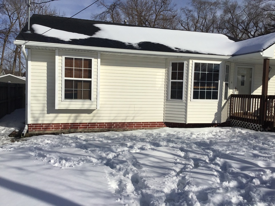 """Des Moines, IA - Install 5"""" white seamless gutters and 3X4"""" downspouts with hinges."""