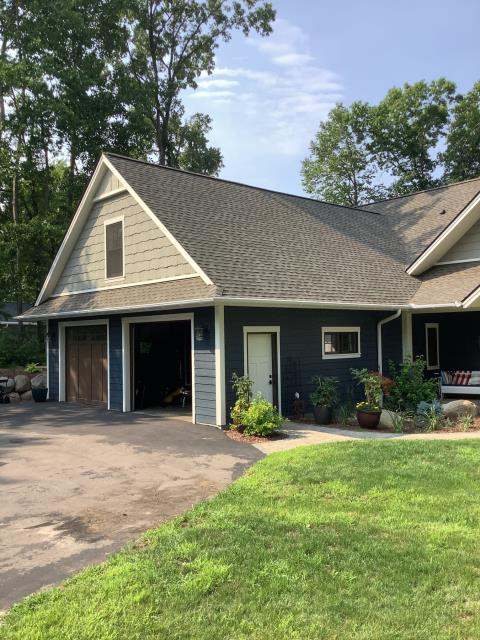 """Lake Shore, MN - Installed new 6"""" half round gutters with 4"""" corrugated downspouts and our Valor gutter protection on this home located in Lake Shore, MN."""